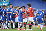 Cesc Fabregas of Chelsea shaking hands with Marouane Fellaini of Manchester United <br /> before k/o. Barclays Premier league match, Chelsea v Manchester Utd at Stamford Bridge Stadium in London on Saturday 18th April 2015.<br /> pic by John Patrick Fletcher, Andrew Orchard sports photography.