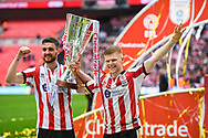 Luke Waterfall of Lincoln City (5) and Elliot Whitehouse of Lincoln City (4) celebrate winning the Checkatrade Trophy during the EFL Trophy Final match between Lincoln City and Shrewsbury Town at Wembley Stadium, London, England on 8 April 2018. Picture by Stephen Wright.