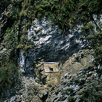 PERU, Archaeology. Pre-Incan (Chachapoyan) tomb on cliff above Huabayacu River in upper cloud forests of Amazon basin near Leymebamba.