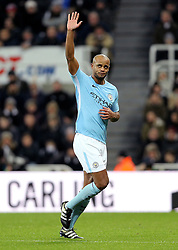 Manchester City's Vincent Kompany acknowledges fans as he comes off the with a injury during the Premier League match at St James' Park, Newcastle.