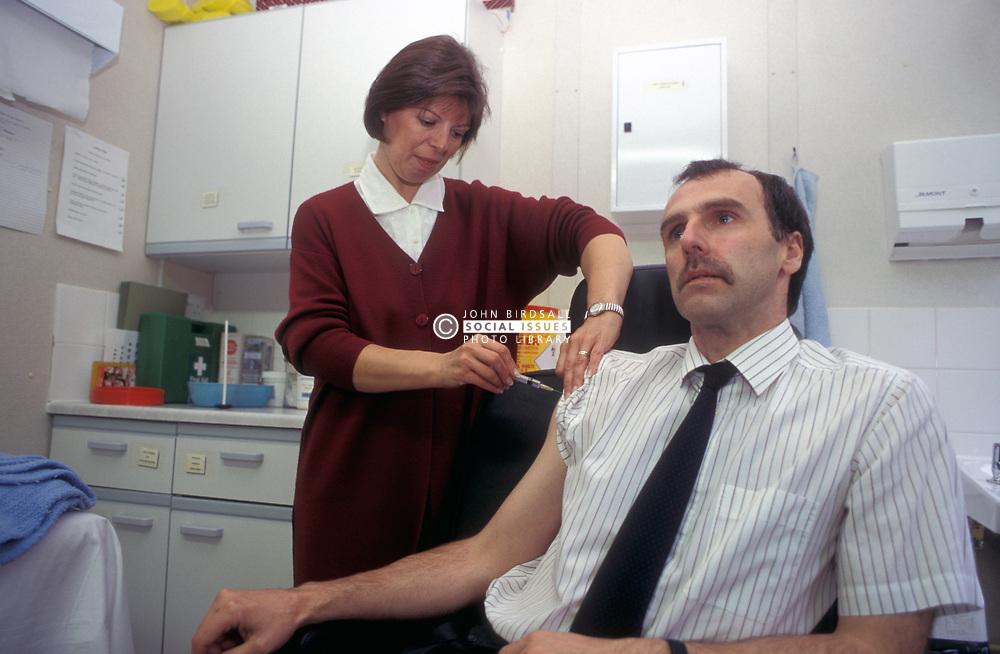 Man getting tetanus injection; Employee Health Care Service; Huddersfield UK