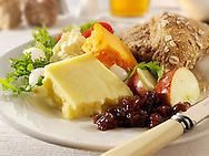 Traditional cheese Ploughman's lunch with Cheddar, and Lancashire cheese photos