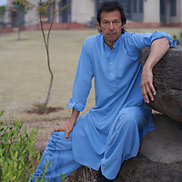 Imran Khan in the grounds of his house which sits on a hill overlooking Islamabad.<br /> <br /> Cricketer Imran Khan made his Test debut against England in 1971. He became captain of the Pakistan team in 1982 and lead them to World Cup victory in 1992 after which he retired.<br /> <br /> Imran Khan established the Tehrik-e-insaaf (or Moverment for Justice) in 1996. Through Tehrik-e-insaaf, Khan has demanded that the Pakistan government make institutional reforms to address corruption and end the present dictatorship. Khan would like a more equitable distribution of resources in Pakistan, the granting key civil liberties and an increas in public service spending. He is particularly scathing of the relationship between President Musharraf and US President Bush.<br /> <br /> Imran Khan became a Member of the Pakistani Parliament for Mianwali, Panjab, in the October 2002 elections.<br /> <br /> Photo: Tom Pietrasik<br /> Islamabad Pakistan<br /> 27th January 2006