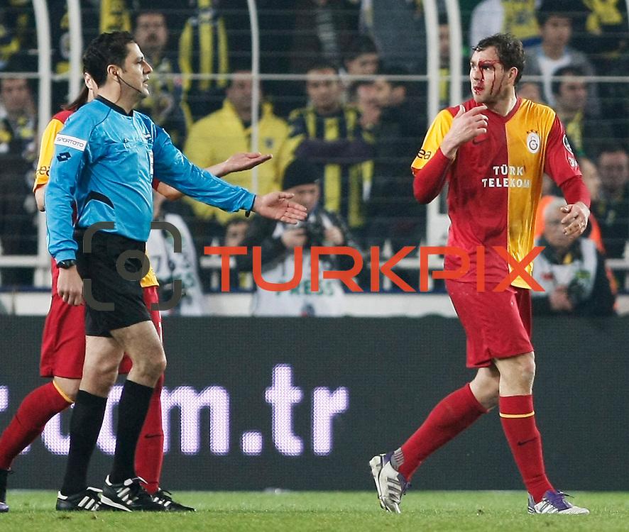 Galatasaray's Johan Elmander (R) during their Turkish superleague soccer derby match Fenerbahce between Galatasaray at Sukru Saracaoglu stadium in Istanbul Turkey on Saturday 17 March 2012. Photo by TURKPIX