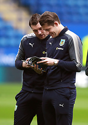 """Burnley's Sam Vokes (left) James Tarkowski read the programme before the Premier League match at the King Power Stadium, Leicester. PRESS ASSOCIATION Photo Picture date: Saturday December 2, 2017. See PA story SOCCER Leicester. Photo credit should read: Mike Egerton/PA Wire. RESTRICTIONS: EDITORIAL USE ONLY No use with unauthorised audio, video, data, fixture lists, club/league logos or """"live"""" services. Online in-match use limited to 75 images, no video emulation. No use in betting, games or single club/league/player publications."""