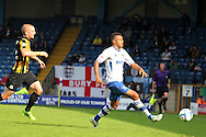 Bury's Tom Soares ® breaks away from Southend's John White for the ball down the wing. Skybet football league two match, Bury v Southend Utd at Gigg Lane in Bury, England on Sat 21st Sept 2013. pic by David Richards/Andrew Orchard sports photography
