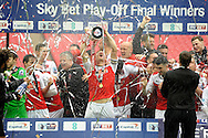 Fleetwood Town players celebrate as they  lift the League Two Playoff Trophy. Skybet football league two play off final match , Burton Albion v Fleetwood Town at Wembley Stadium in  London on Monday 26th May 2014.<br /> pic by John Patrick Fletcher, Andrew Orchard sports photography.