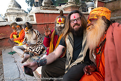 Trip leader Bear Haughton with Shaiva Sadhus (Hindu holy men and followers of Shiva) at Pashupatinath Temple, a sacred Hindu temple complex on the banks of the Bagmati River near Kathmandu during our Himalayan Heroes adventure, Nepal. Saturday, November 3, 2018. Photography ©2018 Michael Lichter.