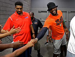 July 21, 2017 - Charlotte, NC, USA - NBA star LeBron James, right, reaches out to shake hands with fans following his son, LeBron Jr.'s tournament game at the Charlotte Convention Center in Charlotte, N.C., on Friday, July 21, 2017. (Credit Image: © Jeff Siner/TNS via ZUMA Wire)