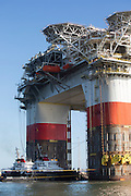 """Chevron's deepwater offshore oil platform """"JACK/ST. MALO"""" being towed offshore from Kiewit in Ingleside, Texas by Crowley Maritime Corporation's OCEAN CLASS Tugs. (Aerial Photography by Tim Burdick)"""