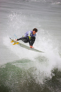 Brett Simpson competing in the Katin Pro/Am surf competition at Huntington Beach Pier, Orange County, California.