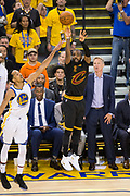 Cleveland Cavaliers guard Kyrie Irving (2) shoots a three pointer over Golden State Warriors guard Shaun Livingston (34) during Game 2 of the NBA Finals at Oracle Arena in Oakland, Calif., on June 4, 2017. (Stan Olszewski/Special to S.F. Examiner)