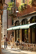 Locals eating breakfast in the Dorsoduro District. Venice, Italy, Europe