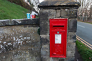 Royal Mail red post box and discarded McDonalds packaging in Rugeley, United Kingdom.