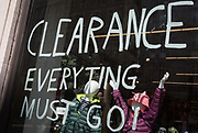 A Clearance Everything Must Go writing in the wondow of an Outdoors retailer on the Strand in the West End, on 13th August 2019, in London England.
