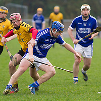 Cratloe's Padraic Collins goes for the slíotar while being pulled back by Clonlara's Cillian Fennessy