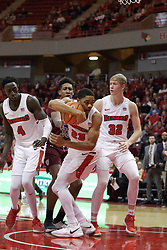 """08 February 2018:  William Tinsley grabs a rebound also sought after by Daouda """"David"""" Ndiaye, Kavion Pippen and Taylor Bruninga during a College mens basketball game between the Southern Illinois Salukis and Illinois State Redbirds in Redbird Arena, Normal IL"""