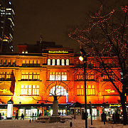 The Bay / La Baie, a famous department store in Montreal as seen from Philips Square, in downtown Montreal in the heart of the shopping and commercial district of the city, at night in the snow and decorated for the holidays.