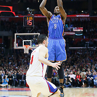 21 December 2015: Oklahoma City Thunder guard Russell Westbrook (0) takes a jump shot over `c4 during the Oklahoma City Thunder 100-99 victory over the Los Angeles Clippers, at the Staples Center, Los Angeles, California, USA.