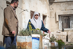 16 February 2020, Irbid, Jordan: Fatima Al-Omari shows her garden to Mohammad Salem, Lutheran World Federation area manager, Irbid. Fatima's family is one of many who have received support from the LWF in setting up home-based farming in the area of Al-Mazar. By providing tools and seeds, the project has helped 150 families grow food for themselves and, in some cases, also earn an income from selling their surplus at local markets.