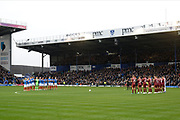 Portsmouth and Ipswich players give a minutes applause in tribute to John Jenkins ahead of the EFL Sky Bet League 1 match between Portsmouth and Ipswich Town at Fratton Park, Portsmouth, England on 21 December 2019.