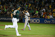 San Francisco Giants relief pitcher George Kontos (70) reacts to Oakland Athletics shortstop Marcus Semien (10) hitting a Grand Slam at Oakland Coliseum in Oakland, California, on July 31, 2017. (Stan Olszewski/Special to S.F. Examiner)