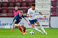 Dominic Solanke (#20) of England U21s (Liverpool) and Ross McCrorie (#20) of Scotland U21s (Rangers FC) during the U21 UEFA EUROPEAN CHAMPIONSHIPS match between Scotland and England at Tynecastle Stadium, Edinburgh, Scotland on 16 October 2018.