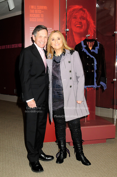 """Melissa Etheridge poses for a photo with Democratic Ohio Congressman Dennis Kuchinich, in front Etheridges' jacket she wore to the 2005 Grammy Award show. The jacket is part of the """"Women Who Rock"""" exhibition sponsored by the Rock and Roll Hall of Fame and the RIAA (Recording Industry Association of America) at NMWA in Washington DC. Sunday Nov. 4th. Grammy award winner Melissa Etheridge is presented with The Excellence in the Performing Arts award from the National Museum of Women in the Arts (NMWA) in Washington DC. Sunday Nov. 4, 2012. Etheridge  also performed on the piano and then an acoustic set on guitar for an intimate audience of about 400 people. Photo ©Suzi Altman/For NMWA Grammy award winner Melissa Etheridge is presented with the National Museum of Women in the Arts' (NMWA) Award for Excellence in the Performing Arts in Washington DC. Sunday Nov. 4, 2012. Etheridge also performed on the piano and then an acoustic set on guitar for an intimate audience of about 300 people. Photo ©Suzi Altman/For NMWA<br /> <br /> Melissa Etheridge NMWA Award for Excellence in the Performing Arts"""