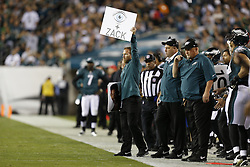 Philadelphia Eagles Sports Science Coordinator Shaun Huls hods up a sign on the sideline during the game between the Kansas City Chiefs and the Philadelphia Eagles in Philadelphia. The Chiefs won 26-16. (Photo by Brian Garfinkel)