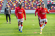 Middlesbrough players warming-up, Middlesbrough assistant coach Leo Percovich watches on before the EFL Sky Bet Championship match between Brentford and Middlesbrough at Brentford Community Stadium, Brentford, England on 7 November 2020.
