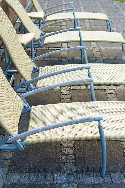 Minimalist Danish style of empty sun lounger seats