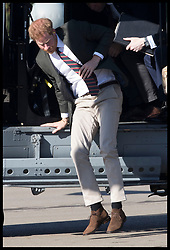 September 13, 2018 - Lympstone, United Kingdom - Image licensed to i-Images Picture Agency. 12/09/2018. Lympstone , United Kingdom. Prince Harry, The Duke of Sussex, jumps out of a helicopter as he arrives for a visit at  the Royal Marines Commando Training Centre in Lympstone, Devon, United kingdom,  for the first time in his role as Captain General Royal Marines. (Credit Image: © Stephen Lock/i-Images via ZUMA Press)