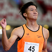 Chong Wei Guan (#45) of Singapore Sports School finishes first with a timing of 11.06s in the A Division boys' 100m final. (Photo © Eileen Chew/Red Sports)