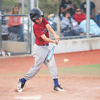 Shad Merayo gets a hit for the Angels against the Athletics in the Pee Wee Reese league at Ford Canyon Park Friday, May 31 in Gallup.