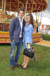 RUPERT FINCH and LADY NATASHA RUFUS-ISAACS at the 2012 Veuve Clicquot Gold Cup Final at Cowdray Park, Midhurst, West Sussex on 15th July 2012.