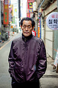 Portrait of a man at Jagalchi Fish Market in Busan, South Korea.