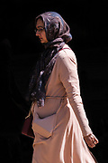 A unknown woman is pictured as she walks through Huddersfield Town Centre during the 2020 Covid Crisis
