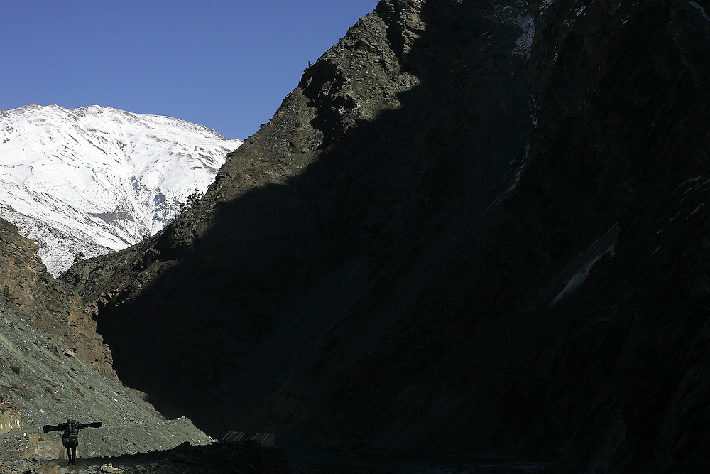 Local porter carry our bag (landes slides cut the road along 8 km).Location Spiti Valley India