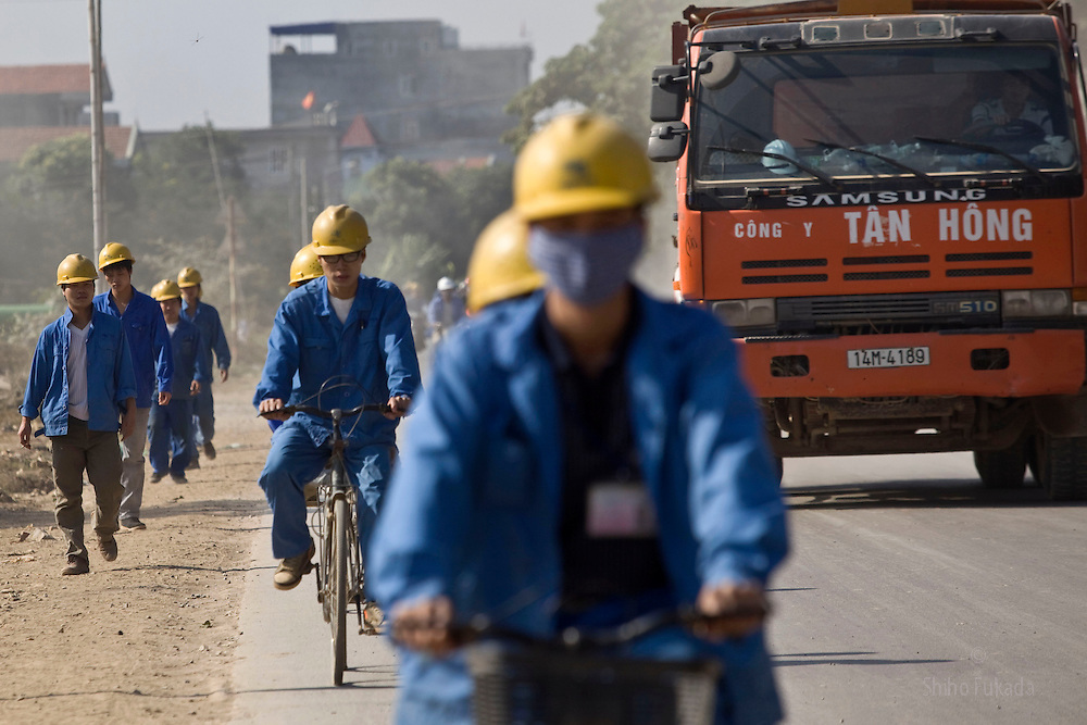 Workers commute to the Haiphong Thermal Power Plant construction site in Trung Son, Vietnam, Nov. 22, 2009. Dongfang Electric, a large Chinese contractor, and Marubeni, a Japanese company, won the $500-million contract in 2005. China, famous for its export of cheap goods, is increasingly known around the world for shipping out cheap labor.