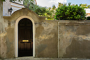 A stucco wall and garden door at 17 Meeting Street in historic Charleston, SC.