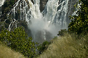 Africa, Namibia - Massive Ruacana falls thunders during the hieght of the rainy season. Once considered the equal of Victoria Falls it now is dammed upstream during the dry months and reduced to a trickle. The falls are on the Kunene river on the border with Angola in the far north of the country.
