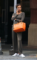 A make-up free Irina Shayk takes a break from baby duties as she is seen chatting on her phone while toting a Hermes bag in Manhattan's Soho Neighborhood. 08 Jun 2017 Pictured: Irina Shayk. Photo credit: LRNYC / MEGA TheMegaAgency.com +1 888 505 6342