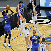 ORLANDO, FL - MARCH 01: Terrence Ross #31 of the Orlando Magic attempts a three point shot over Maxi Kleber #42 of the Dallas Mavericks during the second half at Amway Center on March 1, 2021 in Orlando, Florida. NOTE TO USER: User expressly acknowledges and agrees that, by downloading and or using this photograph, User is consenting to the terms and conditions of the Getty Images License Agreement. (Photo by Alex Menendez/Getty Images)*** Local Caption *** Terrence Ross; Maxi Kleber