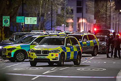 **Incident reported to be connected with the death of Multi-millionaire hotelier Sir Richard Sutton in Dorset**<br /> © Licensed to London News Pictures. 08/04/2021. London, UK. Police vehicle surround a car on Chiswick High Road following a incident in which a vehicle was stopped at approximately 22:30hrs on Wednesday 07/04/2021 when police approached the vehicle, officers discovered the lone male occupant had sustained a number of serious self-inflicted injuries. First aid was commenced immediately and the London Ambulance Service were called. The male has been taken to a west London hospital. Photo credit: Peter Manning/LNP