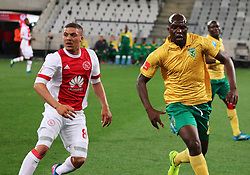 Grant Margeman and Musa Bilankulu in action in the Absa Premiership match between Ajax Cape Town and Golden Arrows at the Cape Town Stadium on Saturday, August 19, 2017.