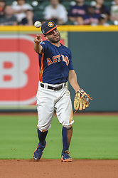 March 26, 2018 - Houston, TX, U.S. - HOUSTON, TX - MARCH 26: Houston Astros infielder Jose Altuve (27) makes a play at first during the game between the Milwaukee Brewers and Houston Astros at Minute Maid Park on March 26, 2018 in Houston, Texas. (Photo by Ken Murray/Icon Sportswire) (Credit Image: © Ken Murray/Icon SMI via ZUMA Press)
