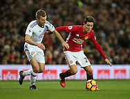 Manchester United's Ander Herrera tussles with Sunderland's Sebastian Larsson during the Premier League match at Old Trafford Stadium, London. Picture date December 26th, 2016 Pic David Klein/Sportimage