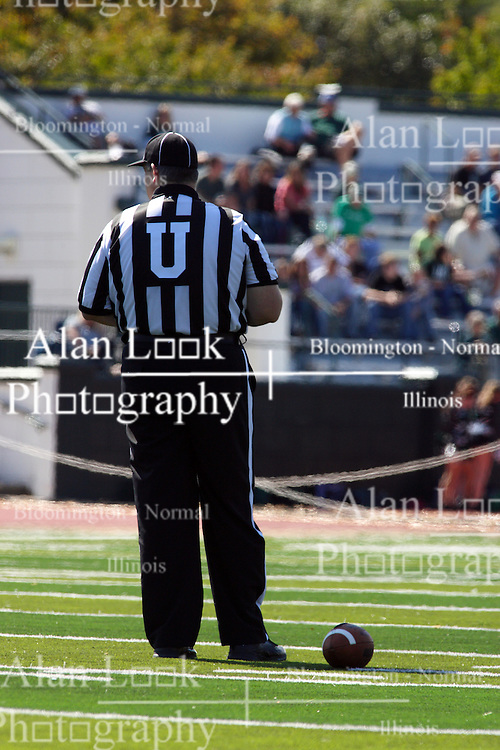 17 September 2011: Umpire Jeff Conrad stands alone seemingly looking for a game while the teams take a timeout during an NCAA Division 3 football game between the Aurora Spartans and the Illinois Wesleyan Titans on Wilder Field inside Tucci Stadium in.Bloomington Illinois.