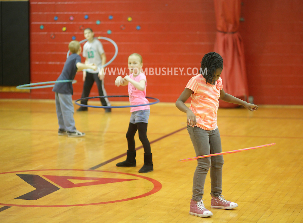 Middletown, New York - Children play with hula hoops at Family Night at the Middletown YMCA on April 2, 2011.
