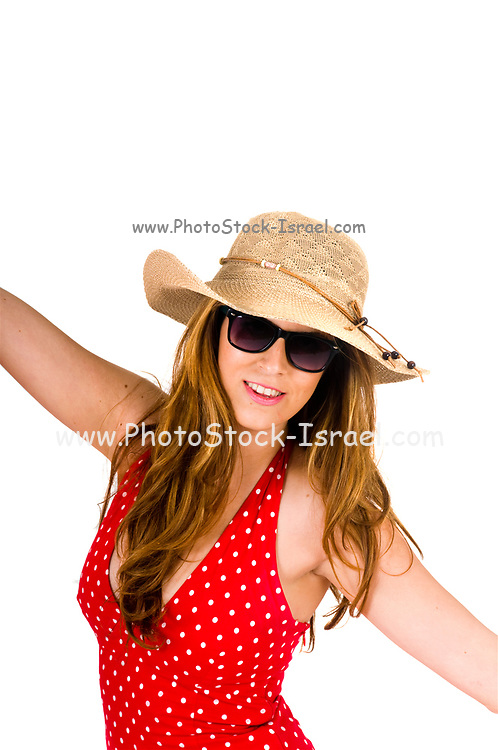 Young woman in summer dress and straw hat isulated on white